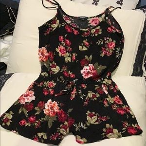 Black romper with floral print